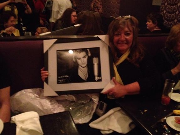 Claudia with her Lee Cherry print personalized and autographed by Adam Lambert. Photo by @shelltwitt86