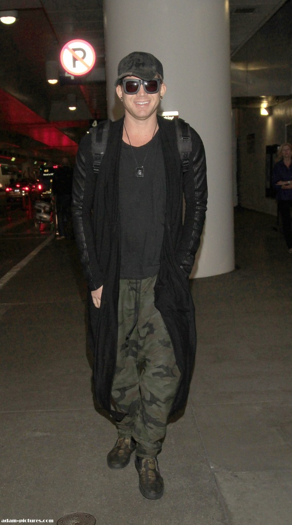 Adam on his way to China. Camo pants are back!
