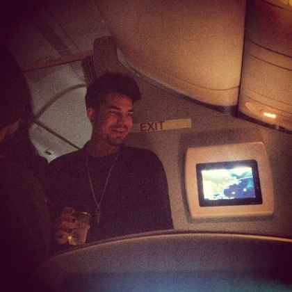 Adam Lambert mixes and mingles.