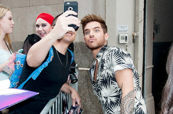 Adam Lambert poses for selfies at Huff Post Live in NY. Splash News and Pictures