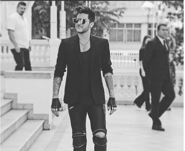 adamlambert#rockinrio press conference. Shades: Thom Browne, jacket: Mugler, Leather pants: @skingraftdesigns gloves: @majestyblack